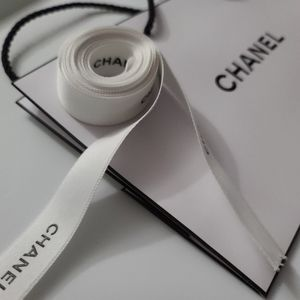 Chanel white and black ribbon with gift bag